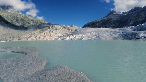 Flying over melting ice floe on glacier lake climate change background Footage