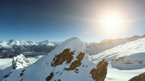 On top of mountain peak aerial view winter landscape Live Action