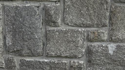 Medieval stone wall. A masonry wall. Stone wall texture background Footage