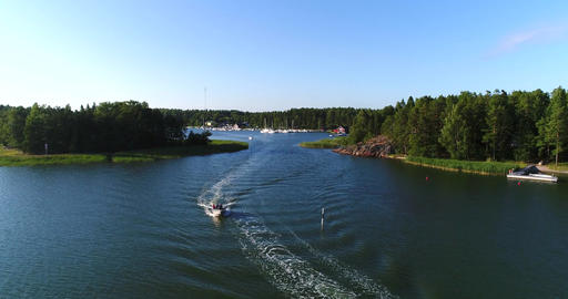 Motorboats leaving a harbor, Cinema 4k aerial view over speedboats leaving a Footage