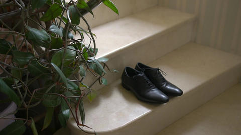 A Pair of Formal Men's Leather Shoes on a Stairs Footage