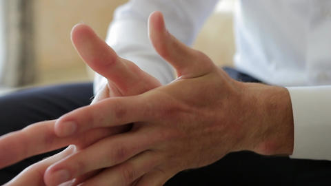 Close Up Male Hands Clenched Together in the Air Footage