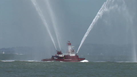 A Fire Fighting Boat In The San Francisco Bay Shooting Water 5 stock footage