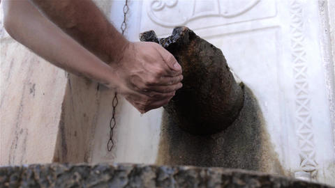 Man gather water in cupped palms and quaff cold water spring 3 Footage