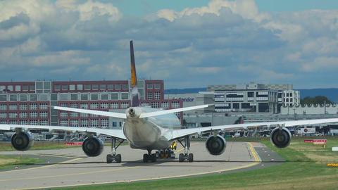 Towing Lufthansa Airbus 340 stock footage