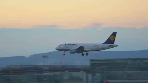 Airbus 319 Approaching And Landing In Dusk stock footage