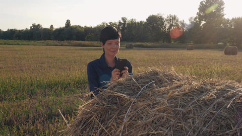 Female agronomist have a break use smartphone for chatting Image