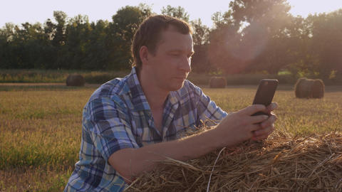Agronomist have a break use smartphone for chatting Footage