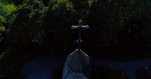 Church cross, Cinema 4k aerial tilt view of the cross sign on the top of pyhan k Live Action