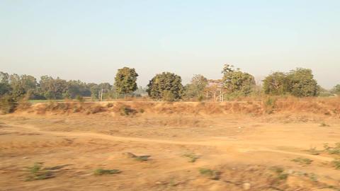 Train running through rural area Image