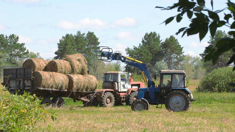 Tractor loading hay 7 Footage