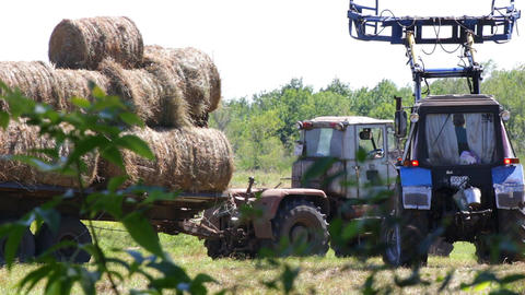Tractor loading hay 1 Footage