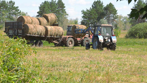 Tractor loading hay 8 Footage