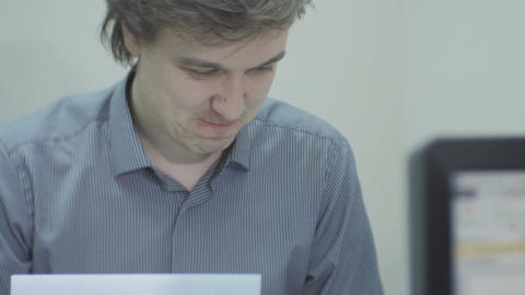 Surprised Manager Looks at Papers and Shows to Colleague Live Action