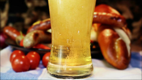 Pouring Beer Into Glass With Bavarian White And Red Sausages Live Action