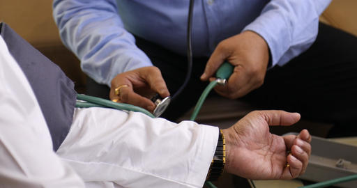 Doctor checking blood pressure on patient Footage