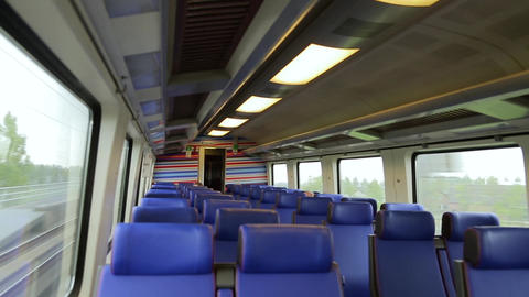Empty interior of a passenger train car in motion Footage