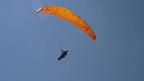 The paraglider flies in sunny day Footage