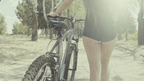 Cute Young Woman Driving A Bicycle Slow Motion Footage