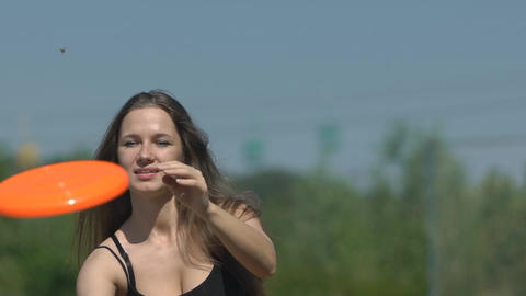 Slow Motion Girl Catching Frisbee Footage