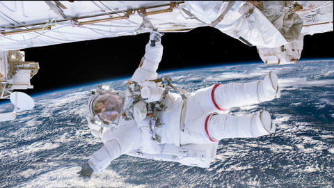 Astronaut working on space station above the Earth. Astronaut Spacewalk, waving 애니메이션