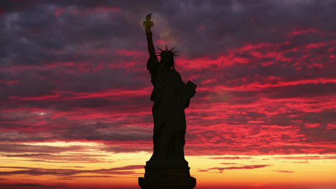 The Statue of Liberty, Sunrise Time Lapse. Sunbeam lights the torch of the Footage