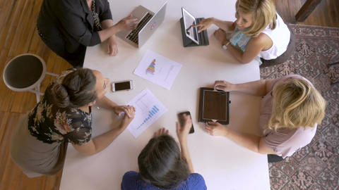 Group of diverse pretty young millennial women in business on laptop, cell Footage