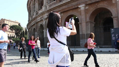 ROME, ITALY - March 25, 2017: Coliseum tourists taking picture via phone near Footage