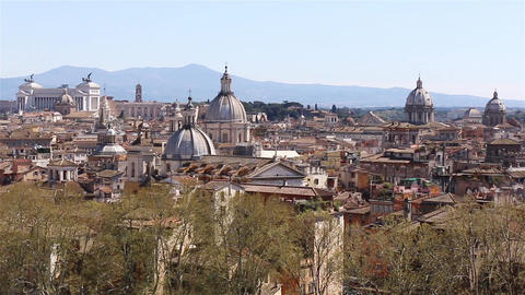 Panoramic view on the rooftops of Rome, Italy. Rome skyline. Panning shot GIF