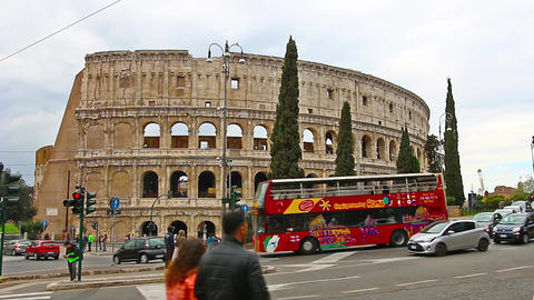 ROME, ITALY - March 25, 2017: Tourist bus in Rome in the background of Colosseum Footage