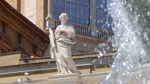 Statue of the saint in front of the fountain at the Square and the Basilica of Footage
