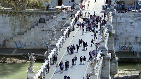 ROME, ITALY - March 25, 2017: People walk across the bridge to Castel Sant Footage
