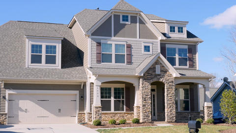 Wide establishing shot of a typical middle class home in a suburban subdivision Footage
