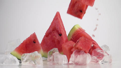 Watermelon Cubes Falling on the Table Archivo