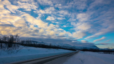 Timelapse of Snowy Winter Road at Sunset Footage