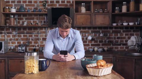 Businessman holding cellular at home 画像