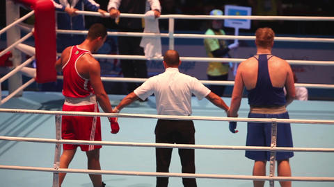 Referee in the ring, announces the winner in a boxing match Footage
