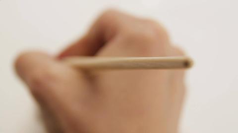 Macro Person Draws Gas Enterprise Logo Contour on White Paper Footage