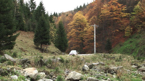 Rally place on a mountain road. A car passing on the road. Rally takes place in  Live Action
