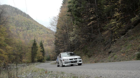 Rally takes place on a mountain road in autumn season. On the road is hardwood t Footage