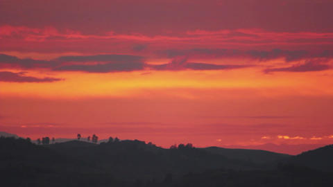 Red sky covered with black puffy clouds in an autumn morning at sunrise. On the  Footage