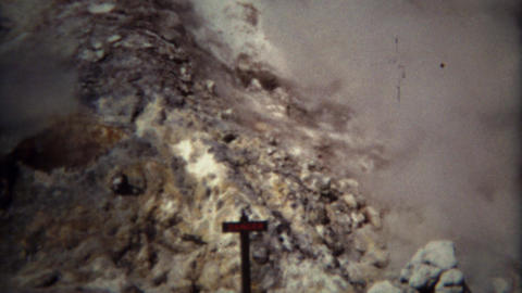 1971: Danger sign with hot volcanic steam rising wasteland Footage