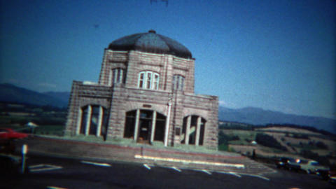 1971: Driving to the sacred religious temple building on sunny day Footage