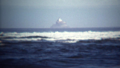 1971: Magic island floating above ocean in near fata morgana mirage Footage