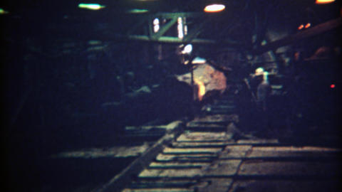 1971: Timber cutting logging factory lumber mill automated board maker Footage