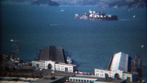 1971: Alcatraz Island and warehouse piers on bright sunny day Footage
