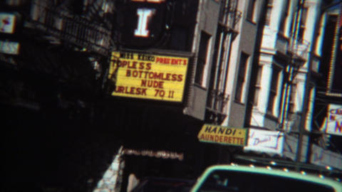 1971: Adult entertainment marquee signs at Columbus and Broadway Footage