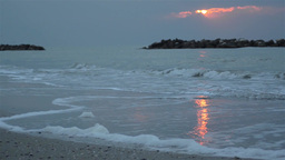 Sunrise at sea. The sun reflects on the wet sand of the beach 10 Footage