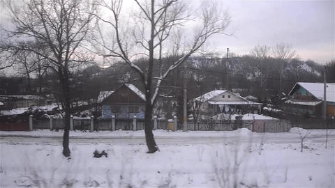 View through the window of a train passing by right of localities covered by sno Footage
