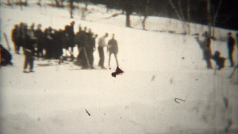 1939: Daredevil downhill skiers taking sharp turn with audience Footage